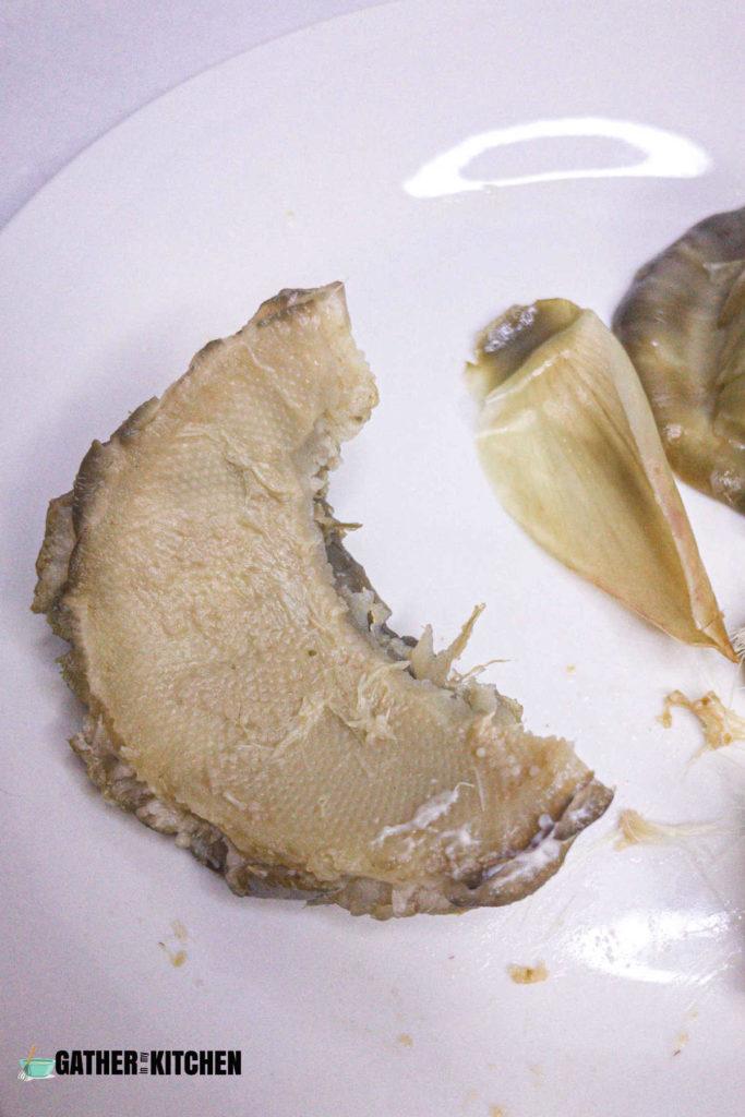 Artichoke heart with a bite taken out.