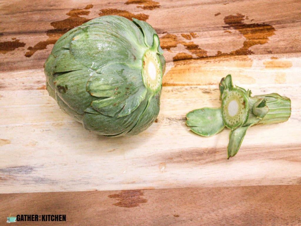 artichoke with cut off stem to the right of it.