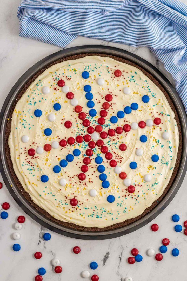 Decorated patriotic brownie pizza.