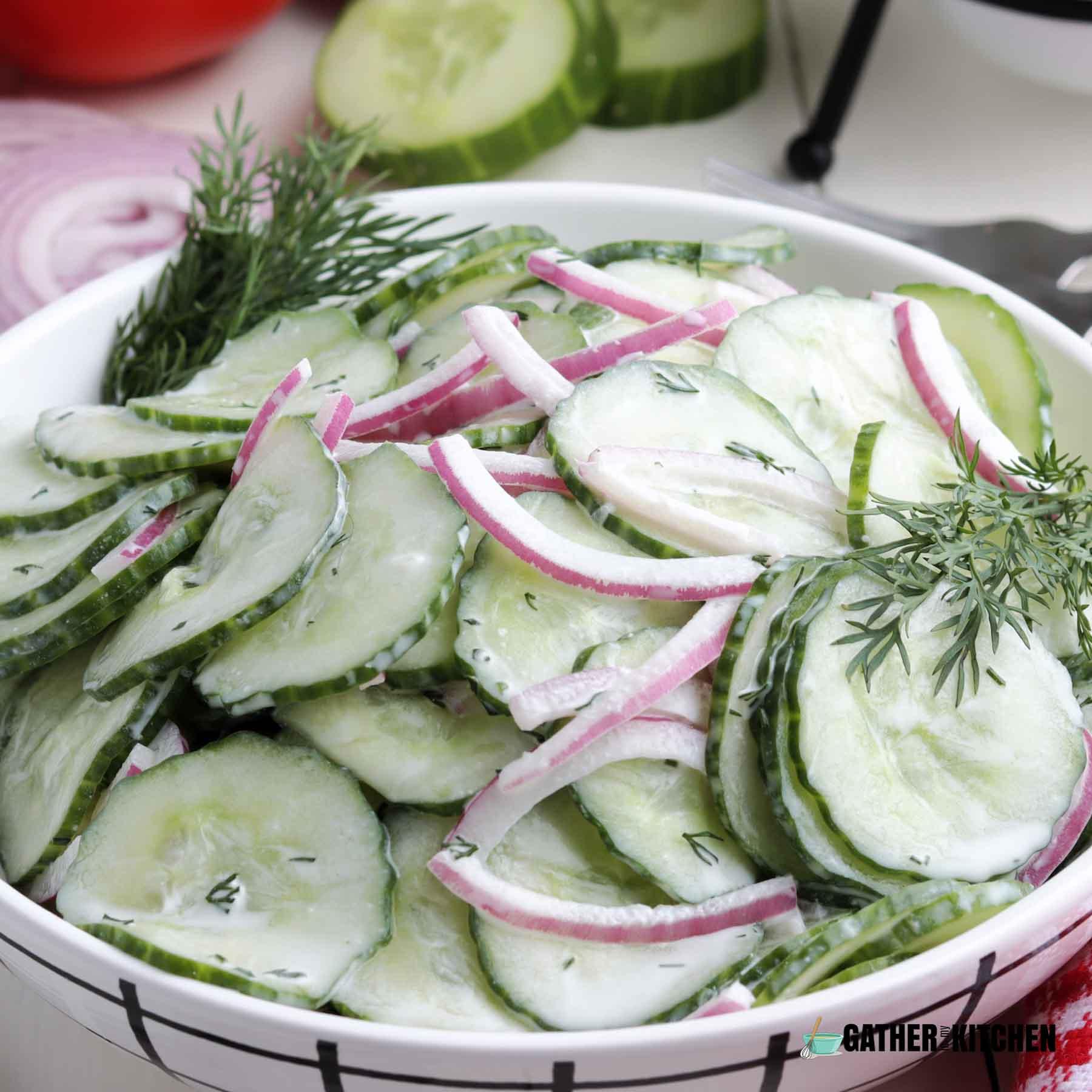Creamy cucumber salad in a bowl.