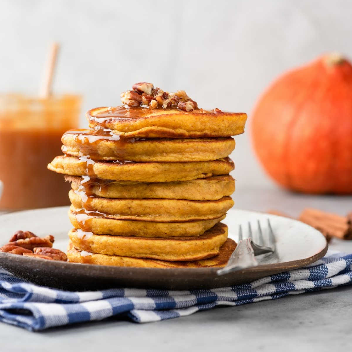 Stack of pumpkin pancakes on a plate.