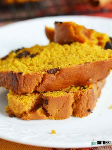 Couple slices of Chocolate chip pumpkin bread stacked on a plate.