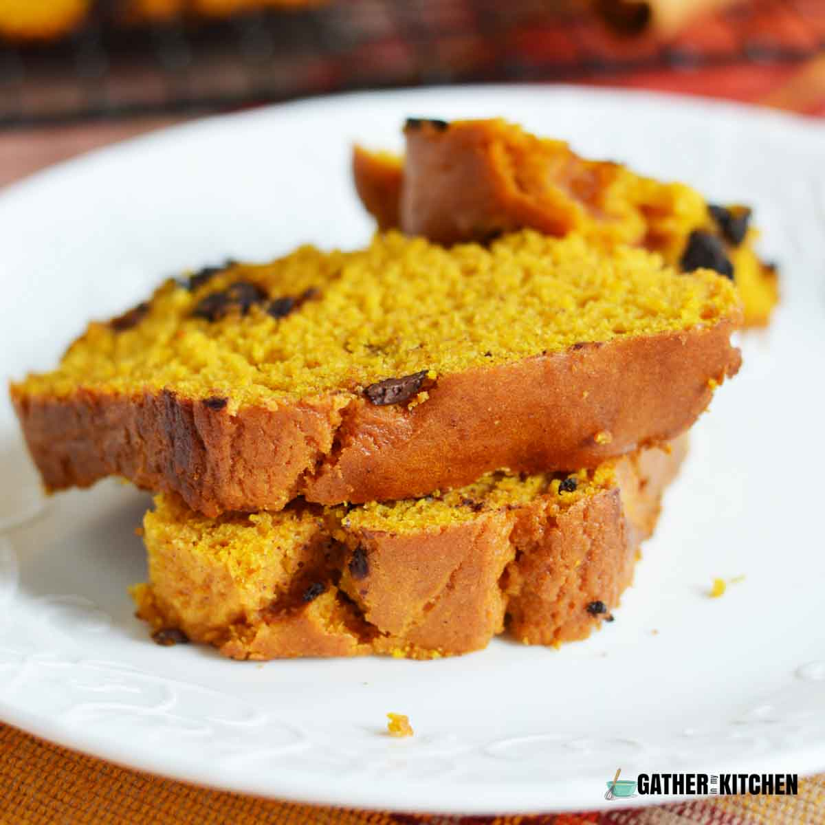 Two slices of pumpkin chocolate chip bread on a plate.