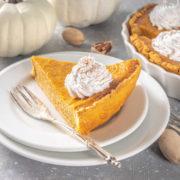 Slide of pumpkin pie on a plate.