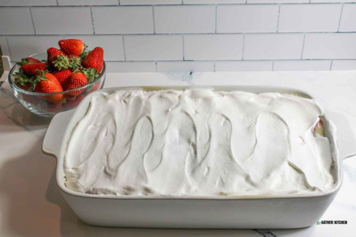 Cake with whipped topping layer.