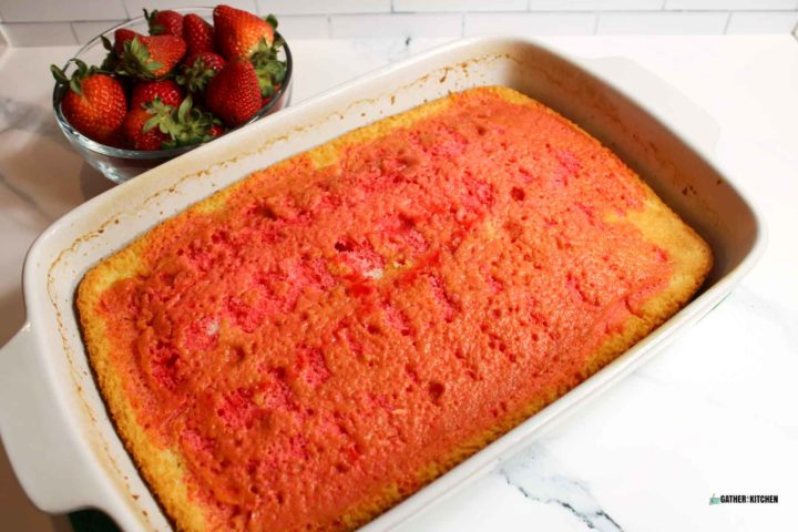 Cake with holes and Jello poured over it.