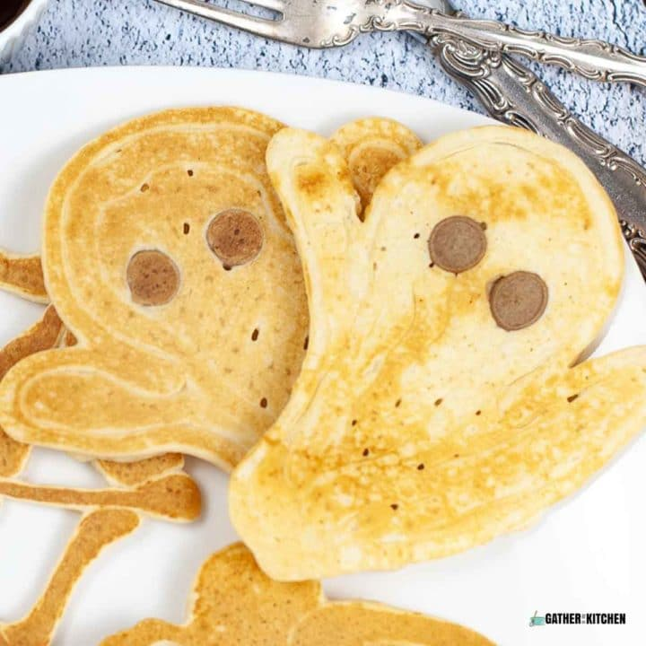 Completed ghost pancakes on a plate.