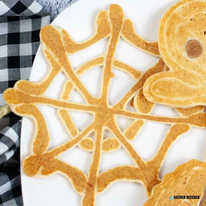 Spider web pancake on a plate.