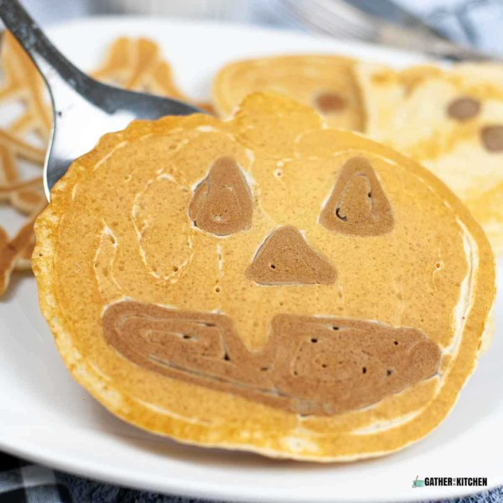 Jack-O-Lantern Pumpkin pancake on a plate.