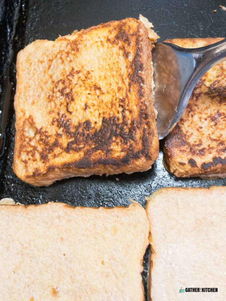 Flipping a piece of French toast.