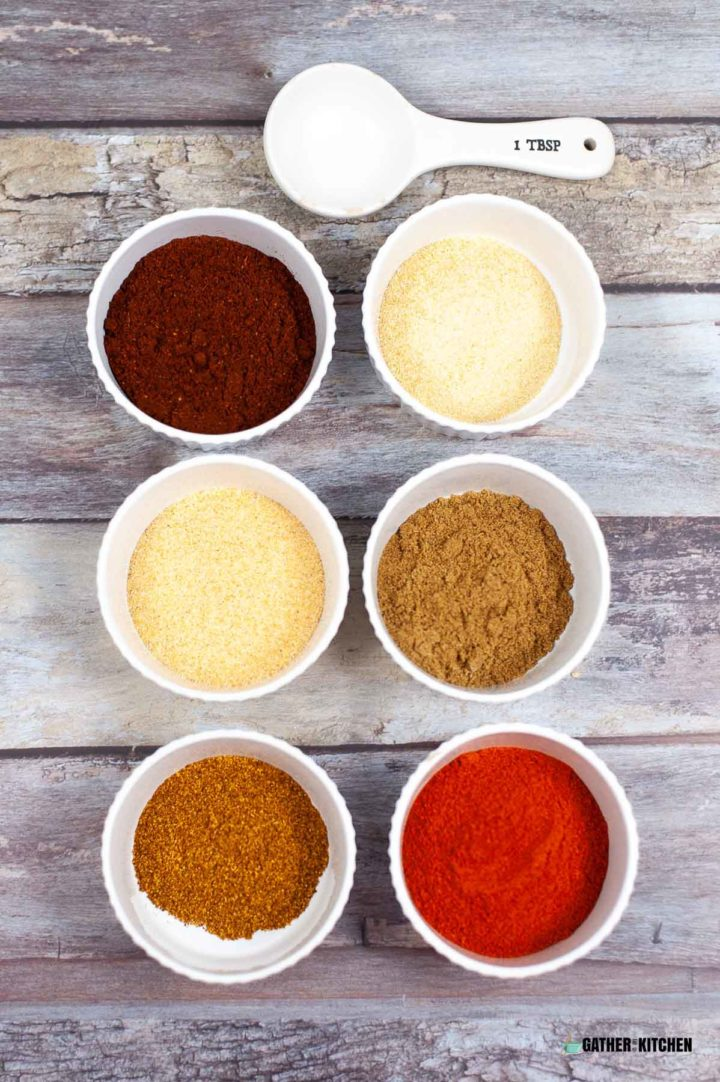 Bowls with each spice for the seasoning mix.