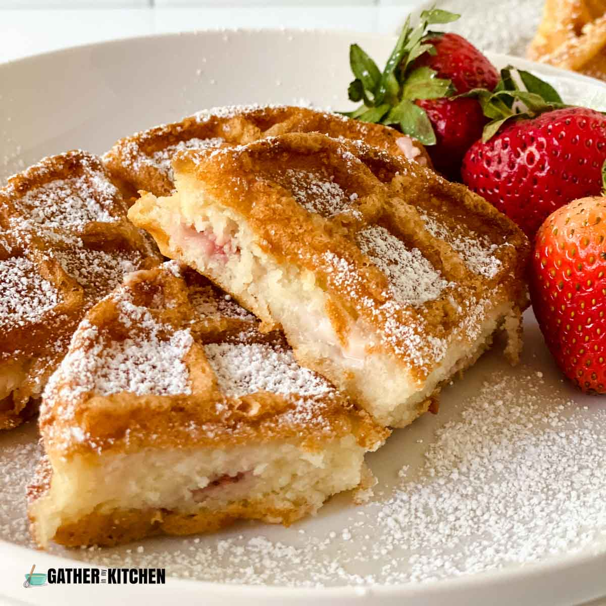 closeup of stuffed waffles with strawberries and cream cheese